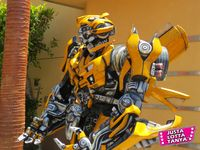 Autobots, Blu-ray, Bumble Bee, Collectible, Collector, Decepticons, Entertainment, Fangirl, geek, Hasbro, Hollywood, Los Angeles, Michael Bay, Optimus Prime, Sexy Geek Girl, Tanya Tate, TF, Thrill ride, Transformers, Transformers Supply Vault, Transformers The Ride 3D, Transformers Trilogy, Universal Studios, Video